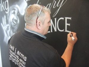 neil arms chalkboard artist at mkg