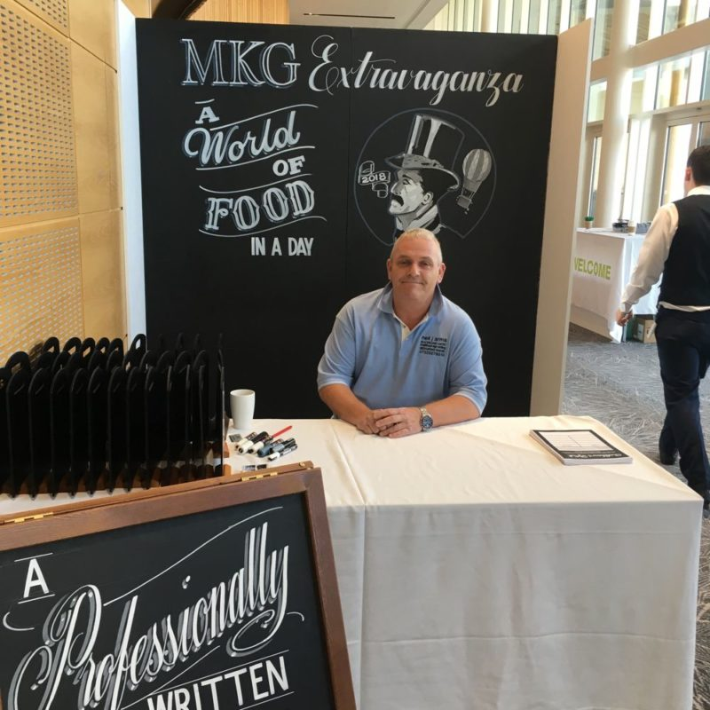 MKG Extravaganza 2018 - Neil Arms creates gorgeous chalkboard art for our guests